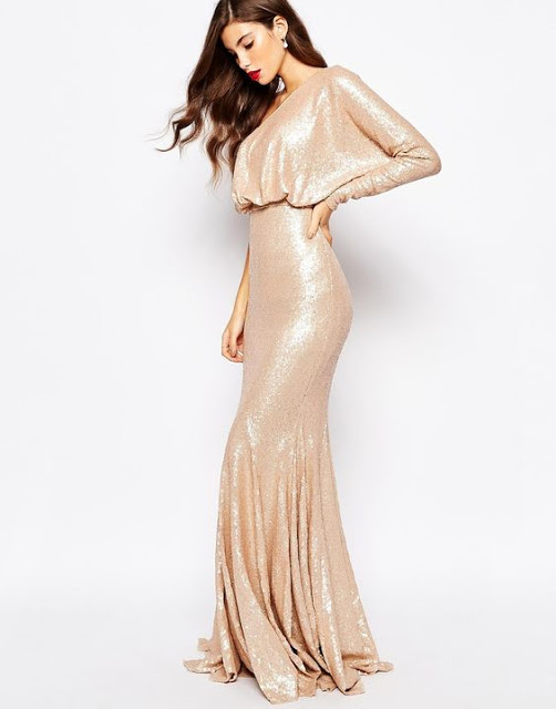http://www.asos.com/Forever-Unique/Forever-Unique-Tempest-Sequin-Maxi-Dress/Prod/pgeproduct.aspx?iid=5829565&cid=5235&Rf1012=4461&sh=0&pge=32&pgesize=36&sort=-1&clr=Gold&totalstyles=1391&gridsize=3